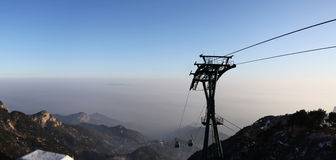 Mount taishan cable car at sunset. This is mount taishan cable car shandong province stock photo