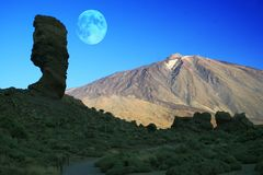 Mount Teide Moon. A view of mount Teide in Tenerife Spain in winter 2006 with the moon in the background stock image