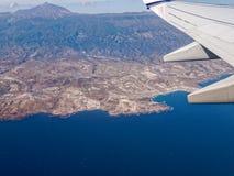 Mount Teide Tenerife Aerial. Aerial view of the Tenerife coastline and Mount Teide, taken from an aeroplane window stock photo