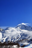 Mount Tetnuldi and off-piste slope with track from ski and snowboard in sun day Stock Photos