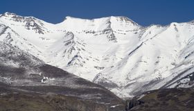 Mount Timpanogos Close-up from West. Mount Timpanogos, an 11,750 feet peak near Sundance Ski Resort in Utah (about 40 miles South of Salt Lake City Royalty Free Stock Photo