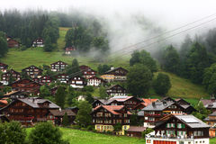 Mount town Wengen in fog. The Wengen in the fog dawn,Switzerland Royalty Free Stock Photos