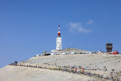 Mount Ventoux. Mont Ventoux, France- July 14 2013: Arid landscape on Mount Ventoux with spectators and technical trucks doing various activities many hours Royalty Free Stock Photography