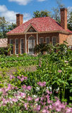 Mount Vernon Greenhouse Washington. The brick building with chimneys of the greenhouse in Mount Vernon, Virginia and the garden with blooming flowers Royalty Free Stock Image