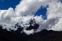 Mount Veronica Peru Surrounded By White Clouds. Snow Covered Mount Veronica Peru With White Clouds Royalty Free Stock Photography