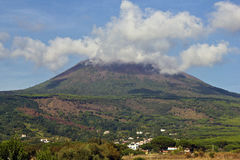 Mount Vesuvius. With clouds at the top of her royalty free stock photo