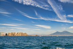 Mount Vesuvius and castle from the sea Royalty Free Stock Photos