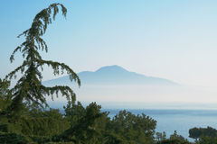 Mount Vesuvius, Italy. View of Mount Vesuvius in the morning haze from the coast of Sorrento, Italy Stock Photography