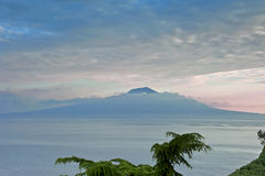 Mount Vesuvius in morning clouds. The view of sleeping Mount Vesuvius wraped up by cloud Royalty Free Stock Photos