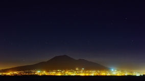 Mount Vesuvius, from Sorrento, Italy. The Mount Vesuvius at night, from Sorrento, Italy Stock Photo