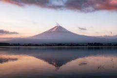 Mount volcano Fuji-san warmth reflection Kawaguchiko Lake at sun. Mount volcano Fuji-san warmth reflection Kawaguchiko Lake at morning stock photos