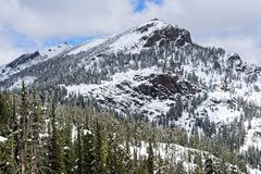 Mount Washburn covered in snow stock images