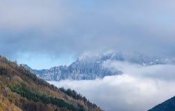 Mount Watzmann silhoette fragments through fog and clouds, Berchtesgadener Land, Bavaria, Germany