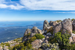 Mount Wellington summit overlooking the Tasmanian coast. Mount Wellington, Hobart, Australia - 7 January 2017: the stunning summit of Mount Wellington Stock Photography