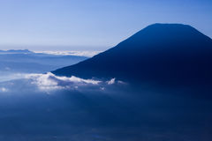 Mount Yotei in a sea of clouds Stock Photos
