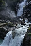 Mountail waterfall. Rocky high mountain setting stock photography