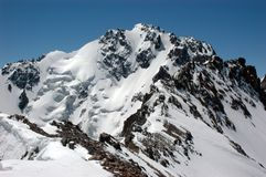Mountain. High rocky mountain covered by glaciers and snow royalty free stock photo