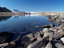 Mountain. Photo. The mountain, reflecting in the lake. Stones Royalty Free Stock Photos