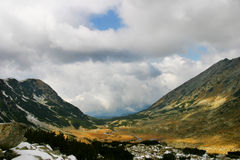 Mountain. Pirin mountain with dramatic sky and sunlight spots Stock Image
