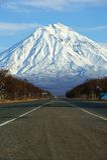 Mountain. Road on background of the snow-clad mountain Stock Photos