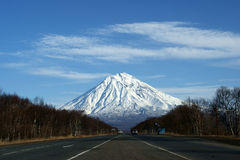 Mountain. Road on background of the snow-clad mountain Royalty Free Stock Photo