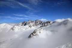 Mountain above clouds Royalty Free Stock Image