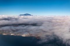 Mountain above clouds - island aerial Royalty Free Stock Images