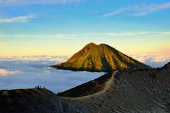 Mountain above the clouds from the rim of the Kawah Ijen volcano Royalty Free Stock Images
