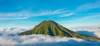 Mountain above the clouds from the rim of the Kawah Ijen volcano Stock Photography