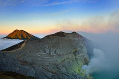 Mountain above the clouds from the rim of the Kawah Ijen volcano Royalty Free Stock Image