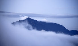 Mountain above clouds Royalty Free Stock Images