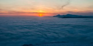 Mountain above the clouds Stock Images