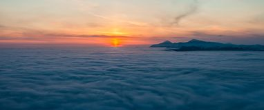 Mountain above the clouds Royalty Free Stock Photo