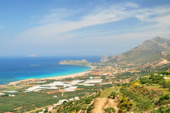 Mountain above a sandy beach on Crete Stock Photo