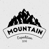 Mountain adventure and expedition insignia badge. Royalty Free Stock Images