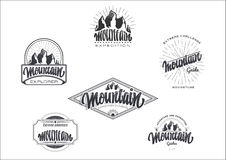 Mountain adventure and expedition insignia badges It can be used as a print on clothing, stamped business cards Stock Images