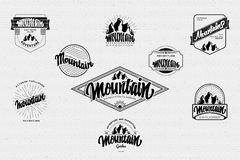 Mountain adventure and expedition insignia badges It can be used as a print on clothing, stamped business cards Royalty Free Stock Photos