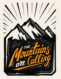 Mountain adventure insignia. Hand drawn mountain adventure insignia with typography design Royalty Free Stock Images