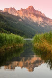 Mountain with afterglow and reflection in the water of a lake Royalty Free Stock Photography