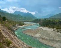 Mountain Alaknanda river in the Himalayas. Mountain Alaknanda river flowing in canyon and the blue sky, Gaucher, Uttarakhand, India Stock Images