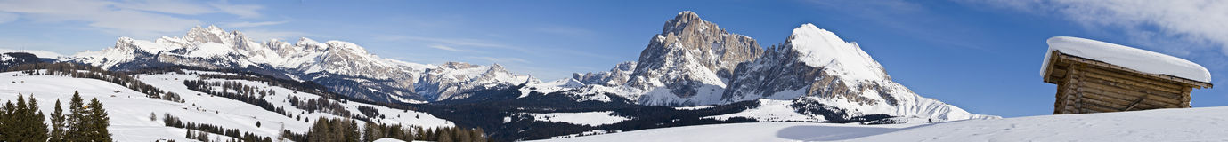 Mountain alps panorama. High resolution panoramic photo view of the alps with snow and chalet Royalty Free Stock Photo