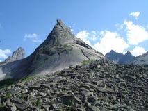 Mountain apex. Mountains apex over blue sky Royalty Free Stock Photo