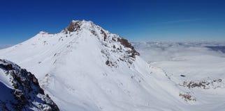 Mountain Aragats Armenia clouds sky. Mountain sky peaks snow sun blue snow Armenia Caucasus sky Royalty Free Stock Photo