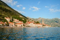 Mountain architectural landscape, view from the sea to the village of Perast, Montenegro royalty free stock photo