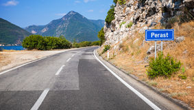Mountain asphalt road and blue road sign Royalty Free Stock Images