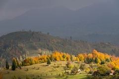 Mountain autumn landscape with colorful forest Stock Photos