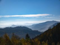 The mountain autumn landscape with colorful forest royalty free stock photo