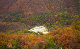 Mountain autumn landscape. With colorful forest and roadway Stock Image