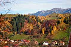 The mountain autumn landscape with colorful forest. Mountain autumn landscape with colorful forest, rural village Royalty Free Stock Images