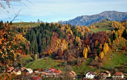The mountain autumn landscape with colorful forest. Mountain autumn landscape with colorful forest, rural village Stock Photo
